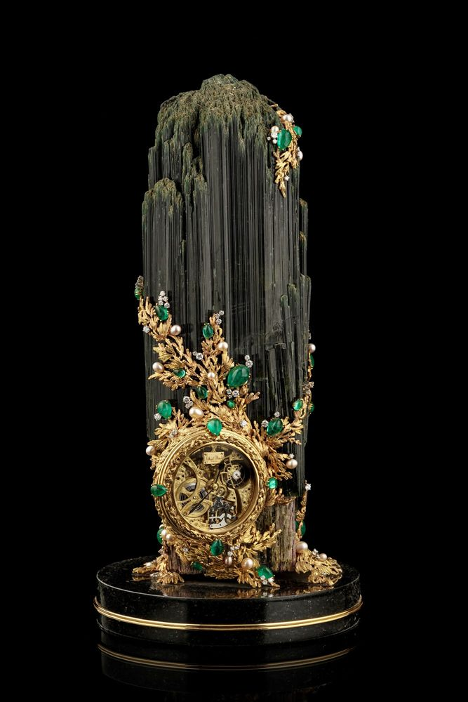 Gilbert Albert. Table clock with tourmaline crystal and black marble pedestal base.