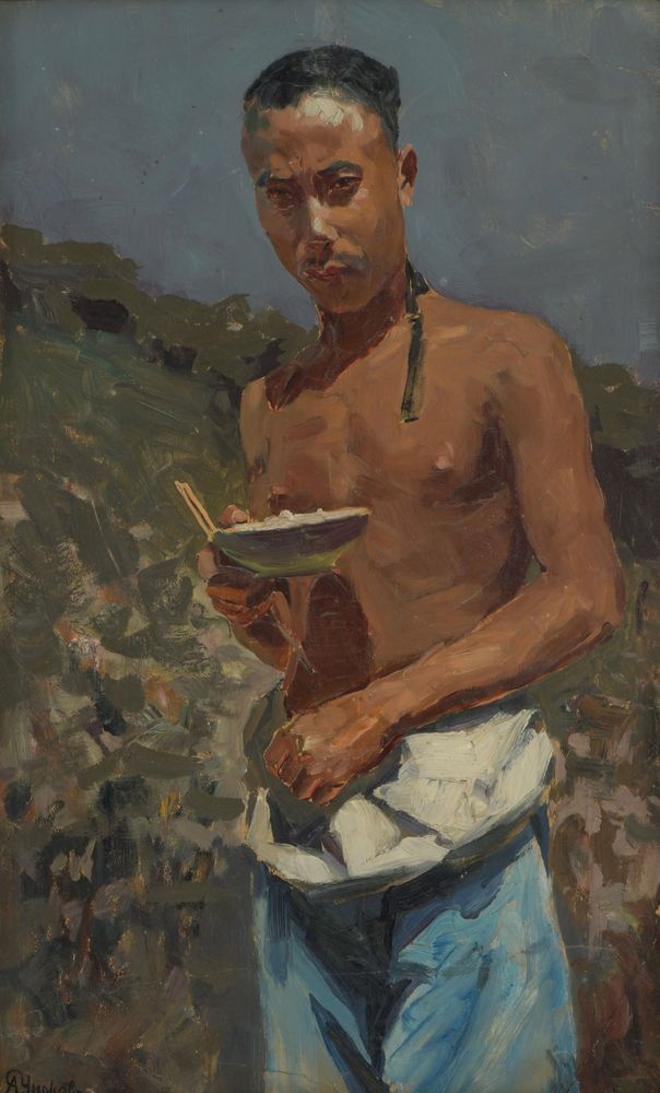 Young man with a bowl of rice. Alexander Chirkov
