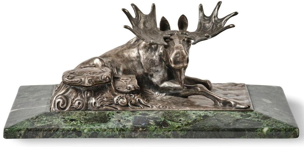An inkpot in the shape of a moose laying down on green marble, Carl Fabergé